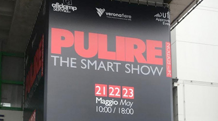 Black trade show sign says Pulire