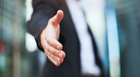 new chance, business executive reaching out to shake hands