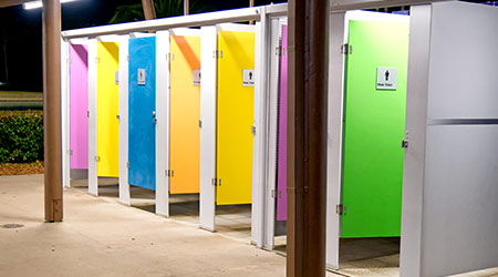 Colorful restroom cabins at night in a city square