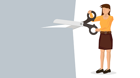 Woman holding a giant scissor cutting across the paper