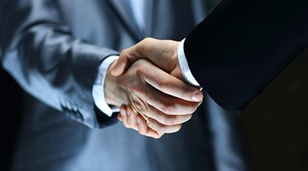 business Handshake - Hand holding on black background
