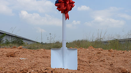 Shovel decorate with ribbon for Groundbreaking Ceremony with beautiful clear blue sky