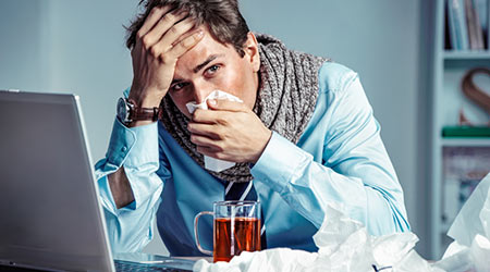 Photo of young man in office suffering virus of flu