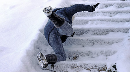 A woman slipped and fell on a wintry staircase