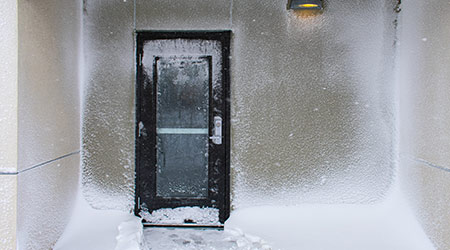 Building Entrance Door With Ice and Drifted Snow