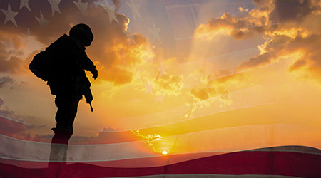 Double exposure Silhouette of Soldier on the United States flag in sunset
