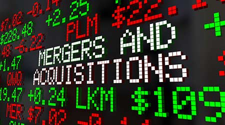 Stock Market Ticker with the words Mergers and Acquisitions