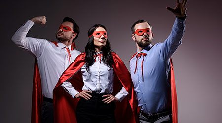 super businesspeople in masks and capes showing superpower isolated on grey