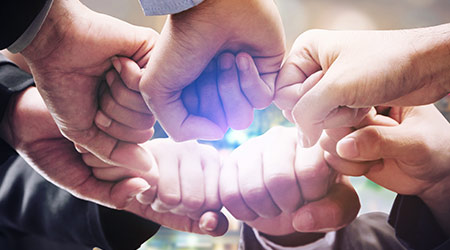 Business people team joining hands
