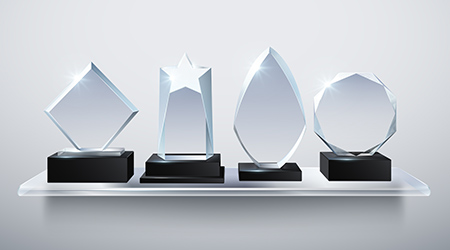 Vector image of four glass trophies