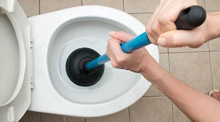Toilet repair by hand plumbing