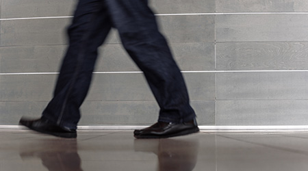 Closeup photo of businessman in black suit going to work