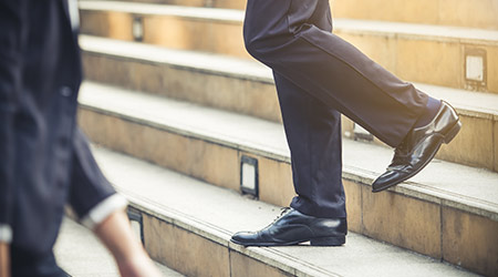 Close up legs of businessman and businesswoman in suit, walking down from stairs, go on business, go down, loss, retired, unemployment and quit from job