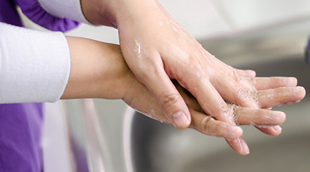 Hygiene technique concept . Washing hands with soap on dental clinic