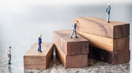 Business, growth and Succession concept. Group of businessman miniature figures walking and standing on wood stair made from wooden blocks toy.