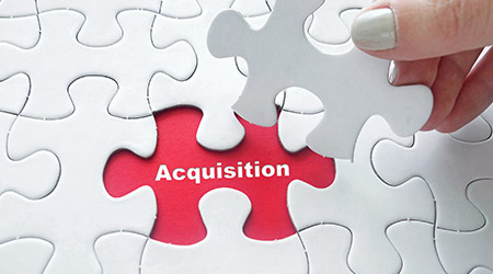 A puzzle piece representing a business acquisition as the missing piece to the puzzle