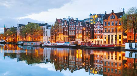 Night city view of Amsterdam, the Netherlands with Amstel River showing