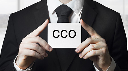 businessman holding small white sign cco