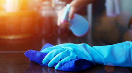 Rubber glove and a microfiber cloth