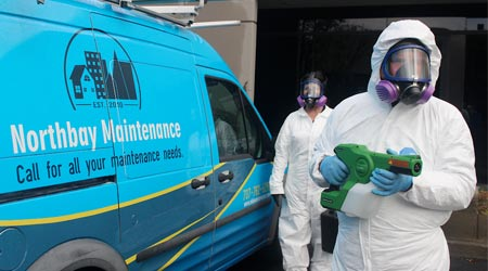 Cleaning company staff dressed in full protective suits to go fight COVID-19