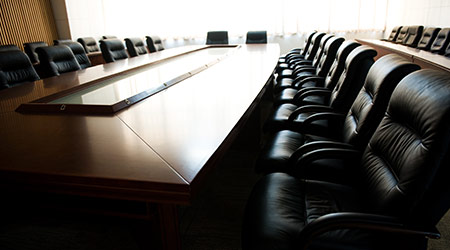 massive wood table and leather chairs for board of directors