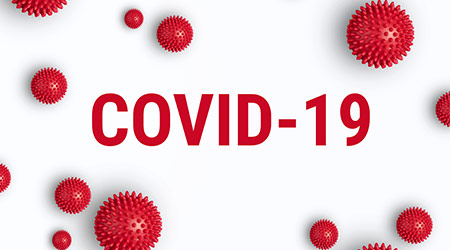 """COVID-19"" written in red on a white background. Images of the viruses cells also displayed"