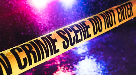 Yellow tape blocking off a crime scene