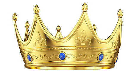 Royal gold crown with sapphires isolated against white background
