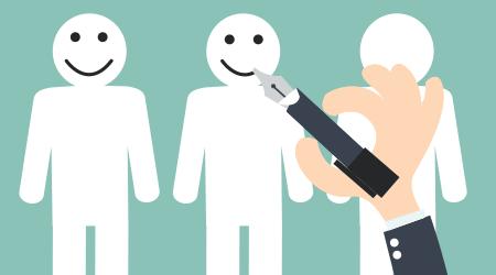 Hand writing smiley face on a cartoon figure. employee retention. customer retention.