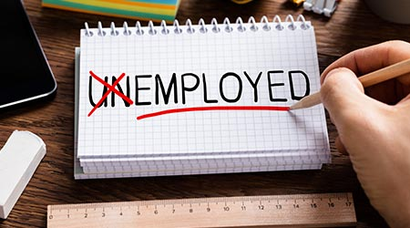 """Un"" in unemployed crossed out to only read employed"