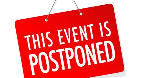 """""""This Event Is Postponed"""" written on cartoon door sign"""