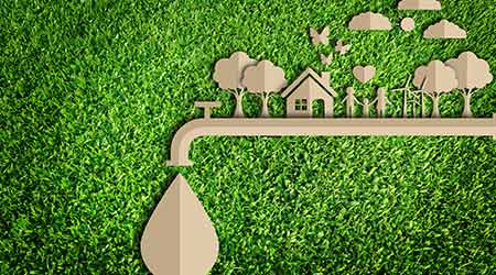 Save water concept. Paper cut of eco on green grass