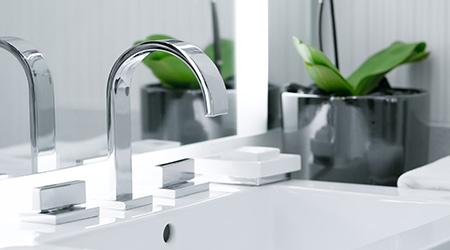 close up view of nice metal faucet in modern bathroom