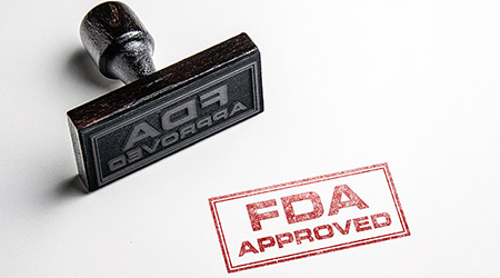 "Rubber stamp that marks ""FDA Approved"""