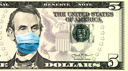 Coronavirus in United States. Concept for quarantine and recession. 5 dollar banknote with a face mask against CoV infection. Global economy hit by corona virus outbreak and pandemic. Digital montage