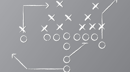 Vector illustration of chalk drawn football play on chalkboard.