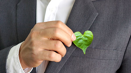 Business man with a leaf shaped like a cartoon heart attached to his suit
