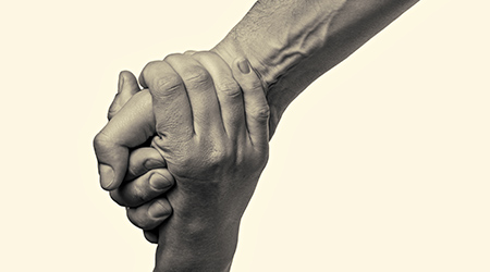one person giving another person a hand