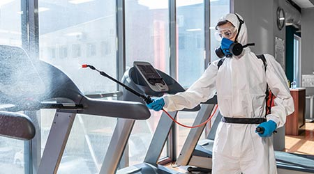 Treadmills at a gym being disinfected