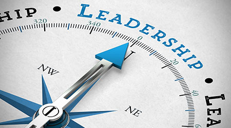Arrow On A Compass Pointing To Leadership