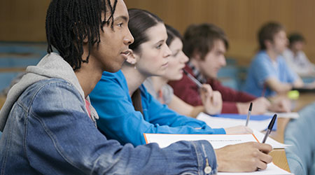 Side view of a group of multiethnic students in lecture room
