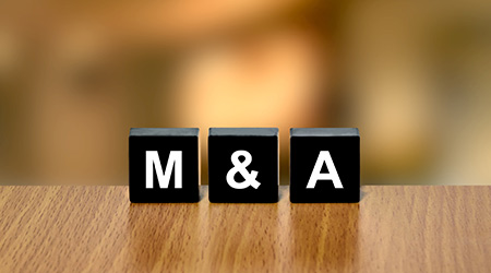 M&A on black block with blurred background
