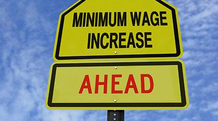A fake traffic sign warning of wage increases