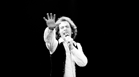 Neil Diamond gestures as he performs at the San Diego Sports Arena circa 1976 in San Diego.