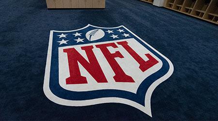 The NFL logo is displayed in the visitors locker room at Mile high Stadium in Denver, Colorado, home of the Denver Broncos