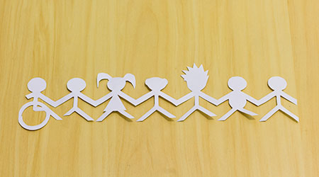A paper cutout of figures intended to depict social inclusion