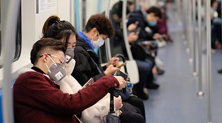 New type coronavirus 2019-nCoV pneumonia in Wuhan has been spreading into many cities in China. People wearing surgical mask sitting in subway in Shanghai