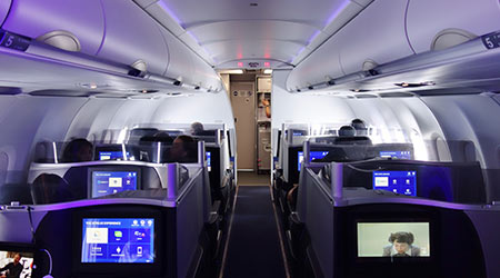 Business class seats inside of a JetBlue cabin