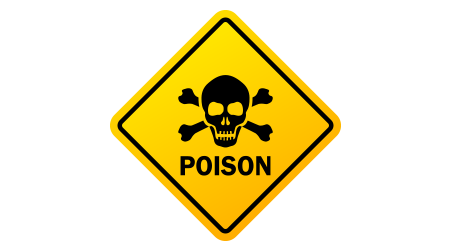 A yellow sign warning people of poison