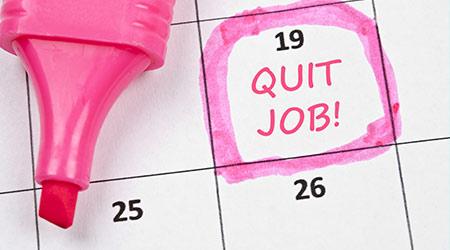"""""""QUIT JOB!"""" written out with pink highlighter on a desk calendar"""